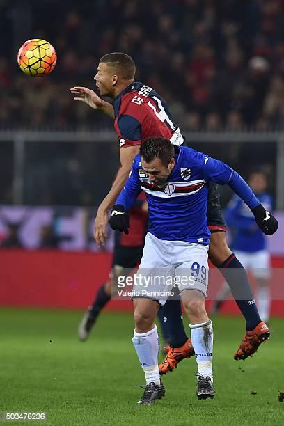 Sebastien De Maio of Genoa CFC clashes with Antonio Cassano of UC Sampdoria during the Serie A match between Genoa CFC and UC Sampdoria at Stadio...