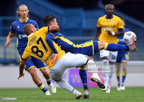 Sebastien De Maio of Udinese Calcio competes for the ball with Samuel Di Carmine of Hellas Verona during the Serie A match between Hellas Verona FC...