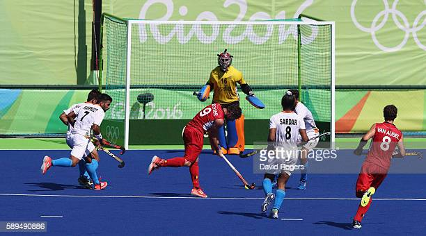 Sebastien Dockier of Belgium scores his first goal of two in their 31 victory during the Men's hockey quarter final match between Belgium and India...