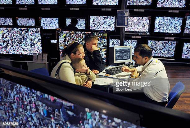 Sebastien Fiel and his family left sit with a sales person in the television department of the Conforama store in Paris France on Tuesday June 16...