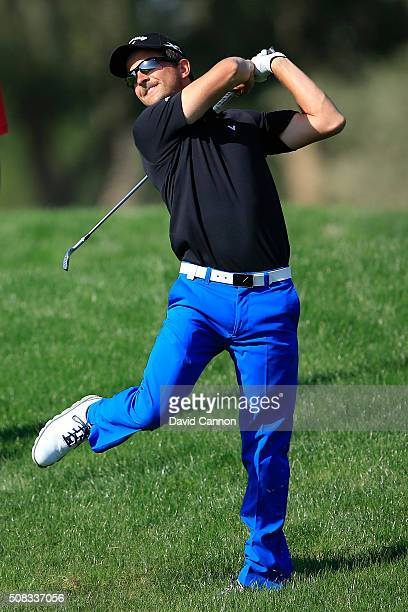 Sebastien Gros of France has to use all his strength from the deep rough for his second shot at the par 4, fifth hole during the first round of the...