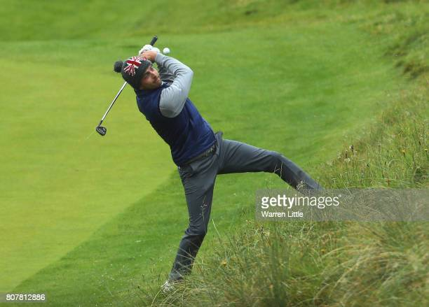 Sebastien Gros of France plays a shot over his head on the second green during previews ahead of the Dubai Duty Free Irish Open at Portstewart Golf...