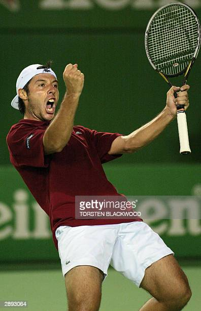 Sebastien Grosjean of France celebrates his victory over Dominik Hrbaty of Slovakia in their men's singles third round match at the Australian Open...