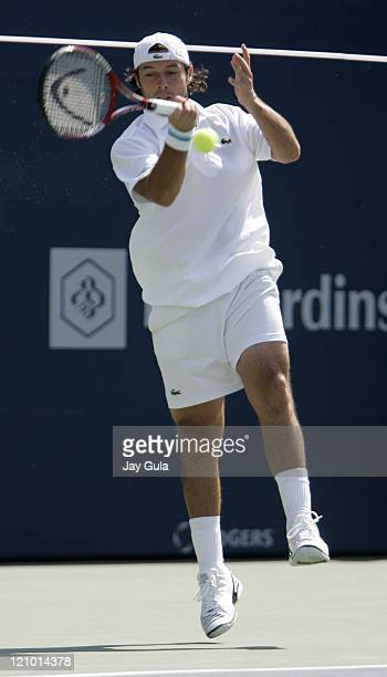 Sebastien Grosjean of France in action during his 2nd round match against Roger Federer of Switzerland in the Rogers Cup at the Rexall Centre in...