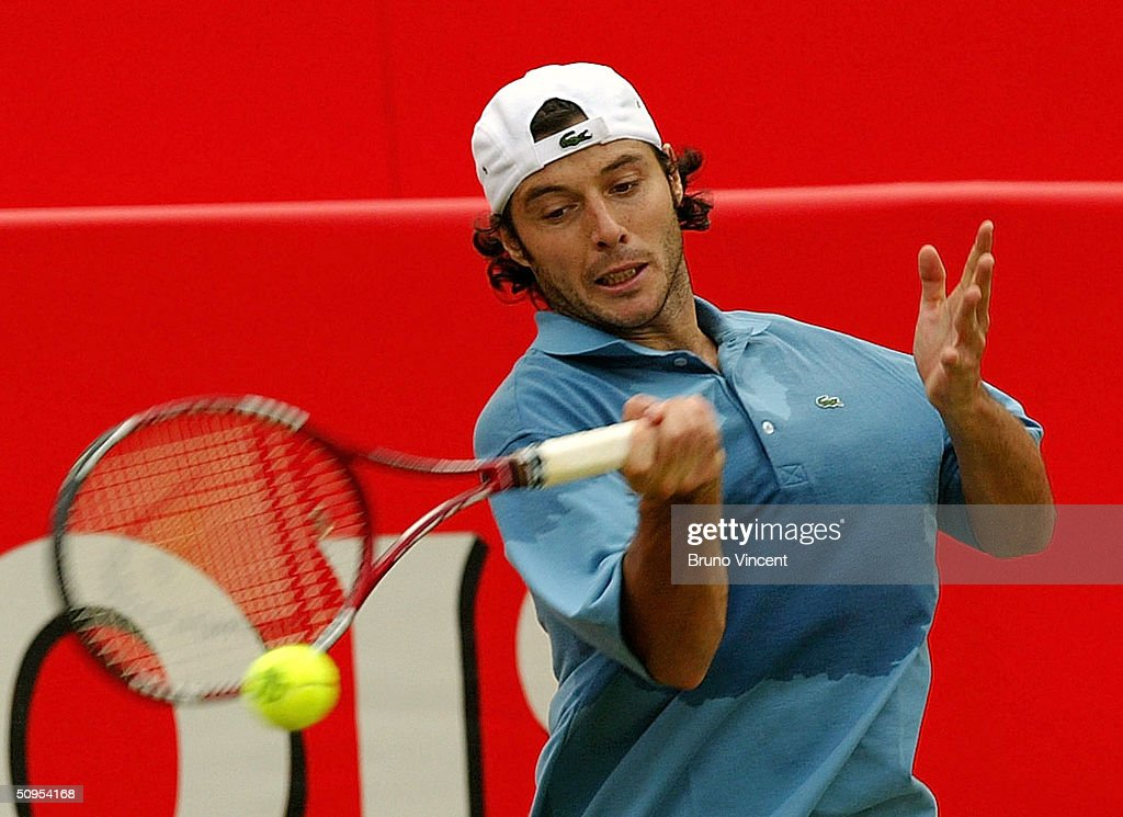 Sebastien Grosjean of France plays a forehand during his semi-final match victory against Hyung-Taik Lee of Korea at the Stella Artois Tennis Championships at the Queen?s Club June 12, 2004 in London, England.