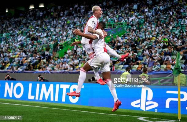 Sebastien Haller of AFC Ajax celebrates after scoring his team's fourth goal with his teammate Antony Matheus Dos Santos during the UEFA Champions...