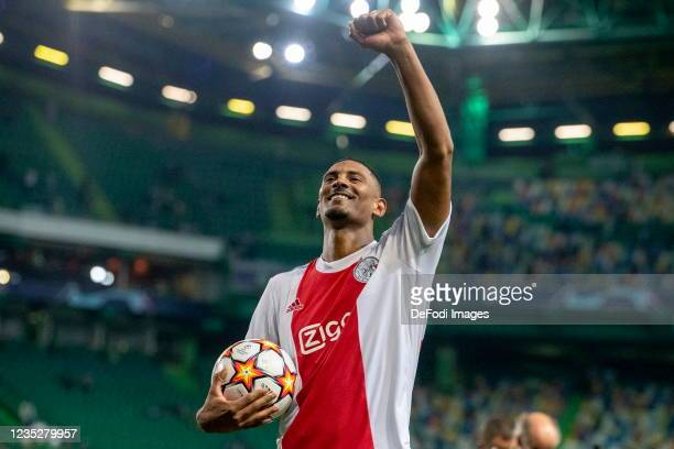 Sebastien Haller of AFC Ajax celebrating his victory and his four goals during the UEFA Champions League group C match between Sporting CP and AFC...