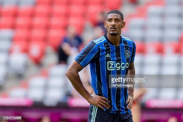 Sebastien Haller of Ajax Amsterdam looks on during the Audi Football Summit Match between FC Bayern Muenchen and Ajax Amsterdam at Allianz Arena on...