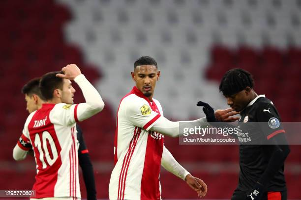 Sebastien Haller of Ajax and Noni Madueke of PSV wait for the corner during the Dutch Eredivisie match between Ajax and PSV Eindhoven at Johan...