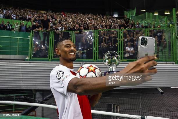 Sebastien Haller of Ajax celebrates victory with the Ajax supporters during the UEFA Champions League match between Sporting CP and Ajax Amsterdam at...