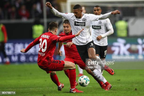 Sebastien Haller of Eintracht Frankfurt and Christian Gunter of SC Freiburg battle for the ball during the Bundesliga match between Eintracht...