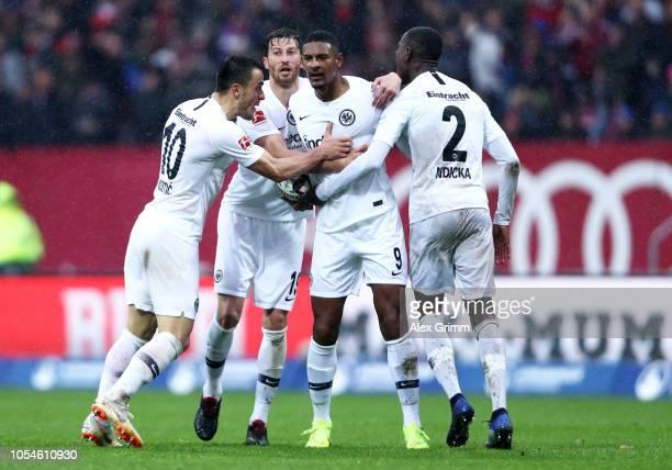 Sebastien Haller of Eintracht Frankfurt celebrates with teammates after scoring his team's first goal during the Bundesliga match between 1. FC...