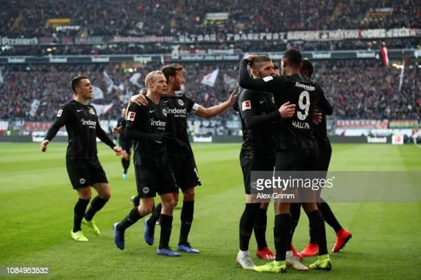 Sebastien Haller of Eintracht Frankfurt celebrates with teammates after scoring his sides first goal during the Bundesliga match between Eintracht...