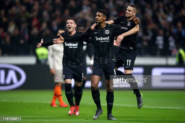 Sebastien Haller of Eintracht Frankfurt celebrates with teammates after scoring his team's second goal during the UEFA Europa League Round of 32...