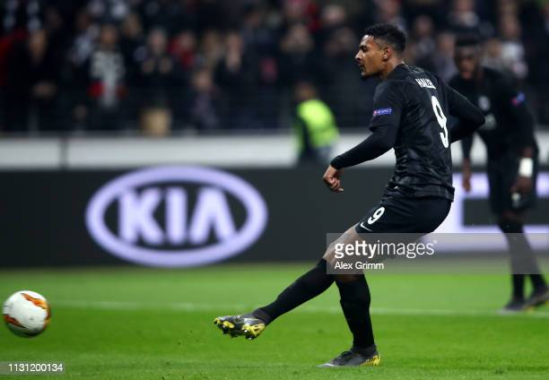 Sebastien Haller of Eintracht Frankfurt scores his team's second goal from the penalty spot during the UEFA Europa League Round of 32 Second Leg...
