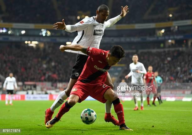 Sebastien Haller of Frankfurt and Charles Aranguiz of Leverkusen compete for the ball during the Bundesliga match between Eintracht Frankfurt and...