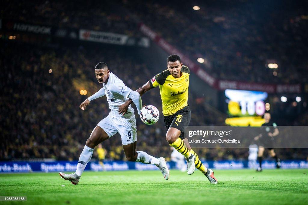 Sebastien Haller (L) of Frankfurt and Manuel Akanji (R) of Dortmund in action during the Bundesliga match between Borussia Dortmund and Eintracht Frankfurt at Signal Iduna Park on September 14, 2018 in Dortmund, Germany.