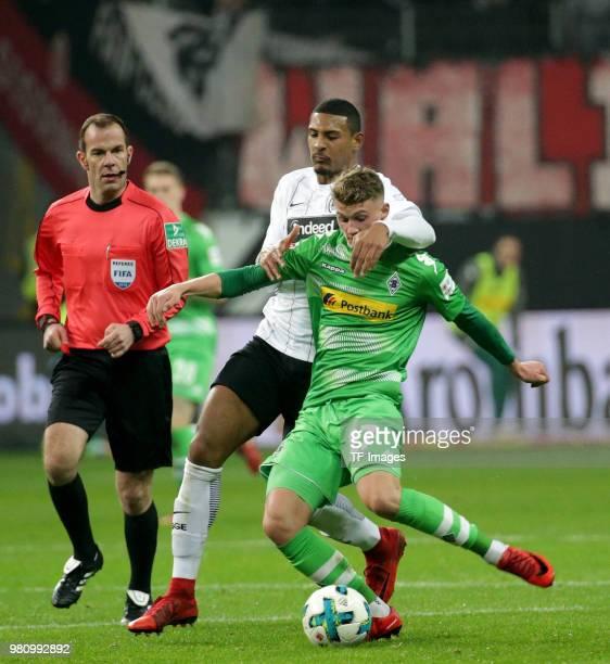 Sebastien Haller of Frankfurt and Michael Cuisance of Moenchengladbach battle for the ball during the Bundesliga match between Eintracht Frankfurt...