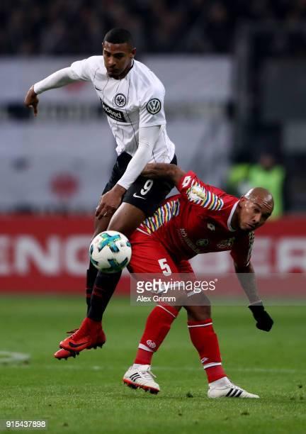 Sebastien Haller of Frankfurt and Nigel de Jong of Mainz battle for the ball during the DFB Cup quarter final match between Eintracht Frankfurt and 1...