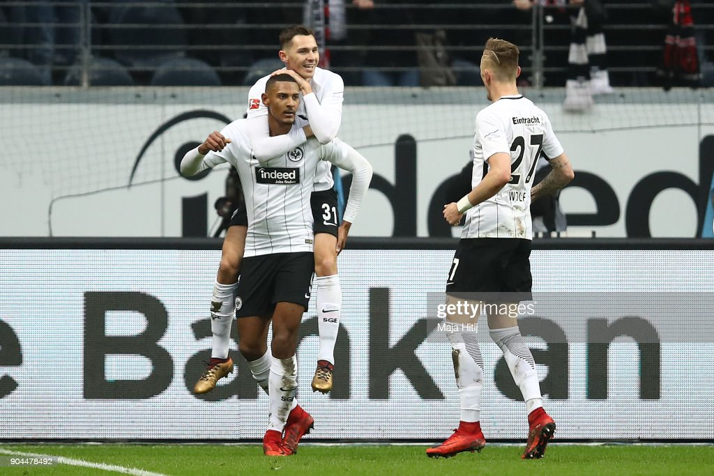 Sebastien Haller of Frankfurt (9) celebrates with Branimir Hrgota of Frankfurt (31) and Marius Wolf of Frankfurt (r) after he scored a goal to make it 1:0 during the Bundesliga match between Eintracht Frankfurt and Sport-Club Freiburg at Commerzbank-Arena on January 13, 2018 in Frankfurt am Main, Germany.