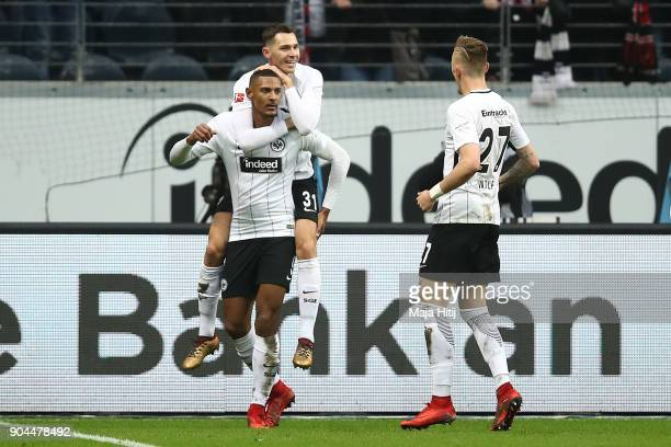 Sebastien Haller of Frankfurt celebrates with Branimir Hrgota of Frankfurt and Marius Wolf of Frankfurt after he scored a goal to make it 10 during...