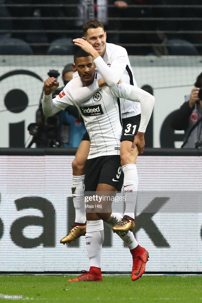 Sebastien Haller of Frankfurt (9) celebrates with Branimir Hrgota of Frankfurt (31) after he scored a goal to make it 1:0 during the Bundesliga match between Eintracht Frankfurt and Sport-Club Freiburg at Commerzbank-Arena on January 13, 2018 in Frankfurt am Main, Germany.