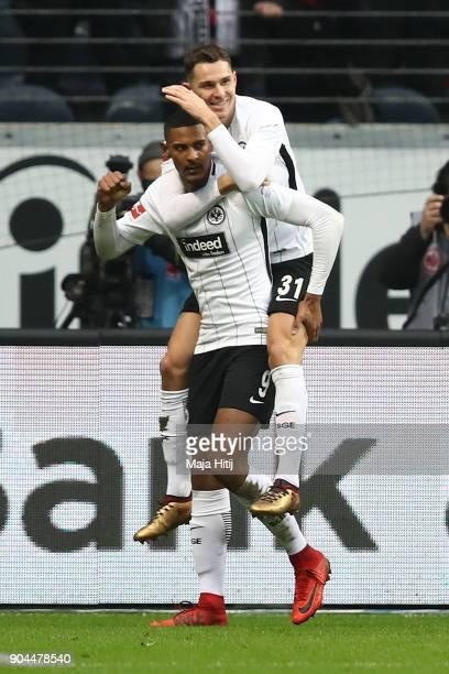 Sebastien Haller of Frankfurt celebrates with Branimir Hrgota of Frankfurt after he scored a goal to make it 10 during the Bundesliga match between...