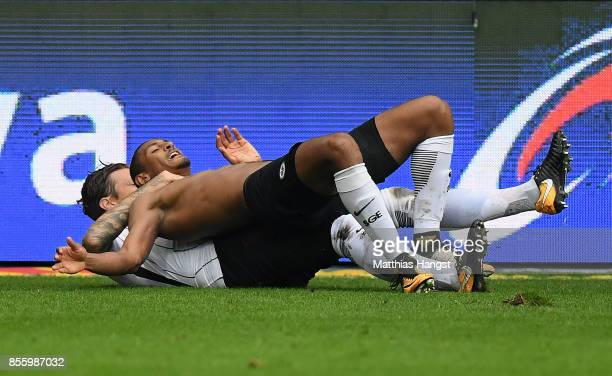 Sebastien Haller of Frankfurt celebrates with his teammate after scoring his team's second goal during the Bundesliga match between Eintracht...