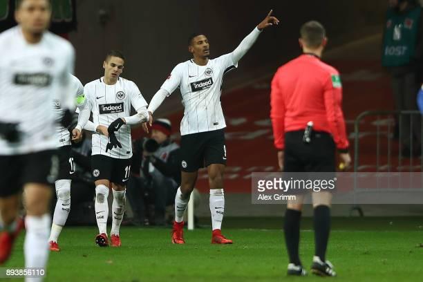 Sebastien Haller of Frankfurt celebrates with team mates after he scored a goal to make it 2:0 during the Bundesliga match between Eintracht...