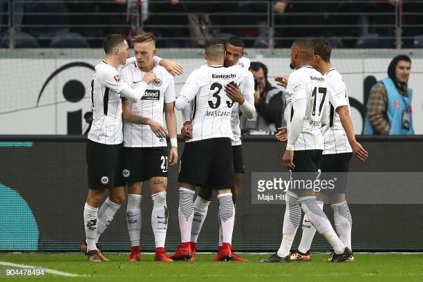 Sebastien Haller of Frankfurt celebrates with team mates after he scored a goal to make it 10 during the Bundesliga match between Eintracht Frankfurt...