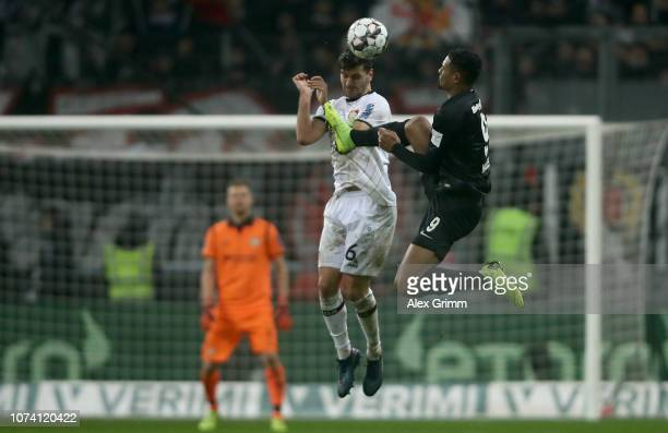 Sebastien Haller of Frankfurt challenges of Aleksandar Dragovic of Leverkusen during the Bundesliga match between Eintracht Frankfurt and Bayer 04...