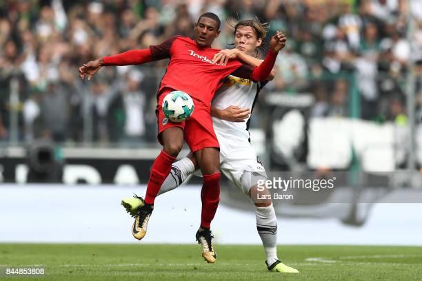 Sebastien Haller of Frankfurt fights for the ball with Jannik Vestergaard of Moenchengladbach during the Bundesliga match between Borussia...