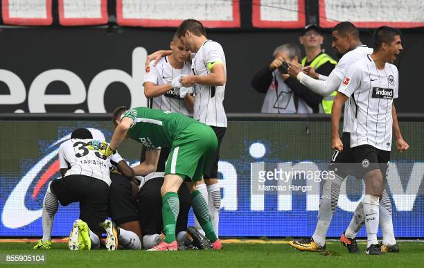 Sebastien Haller of Frankfurt is celebrated by team mates after he scored the late winning goal to make it 21 during the Bundesliga match between...