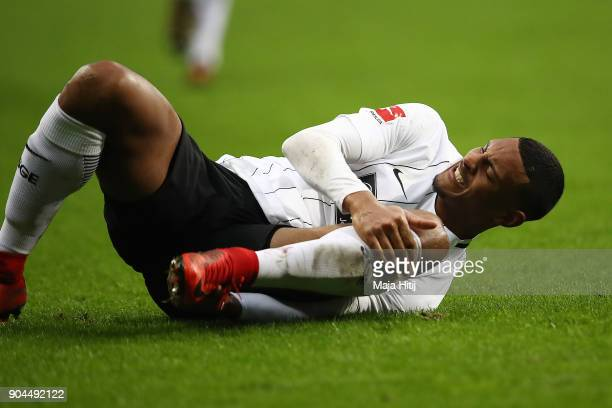 Sebastien Haller of Frankfurt lies on the pitch in pain during the Bundesliga match between Eintracht Frankfurt and SportClub Freiburg at...