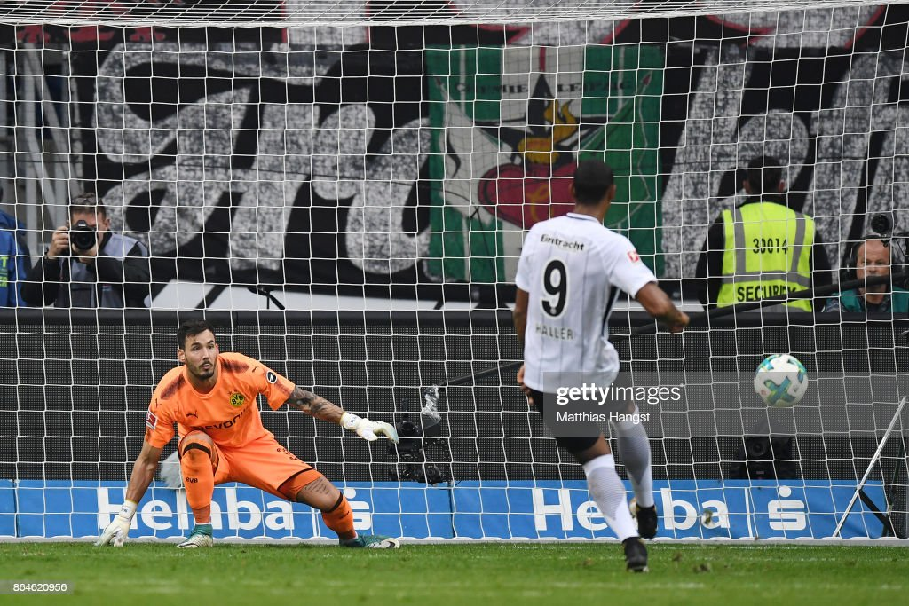 Sebastien Haller of Frankfurt (9) scores a goal from the penalty spot past Roman Buerki of Dortmund to make it 1:2 during the Bundesliga match between Eintracht Frankfurt and Borussia Dortmund at Commerzbank-Arena on October 21, 2017 in Frankfurt am Main, Germany.