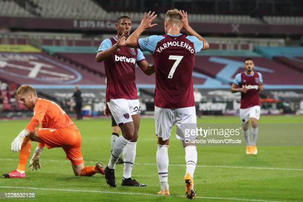 Sebastien Haller of West Ham celebrates scoring the opening goal with Andriy Yarmolenko who provided the assist during the match between West Ham...