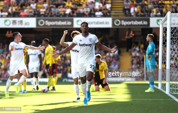 Sebastien Haller of West Ham United celebrates after scoring his team's third goal during the Premier League match between Watford FC and West Ham...