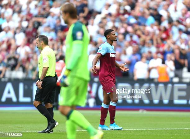 Sebastien Haller of West Ham United celebrates after scoring his team's first goal during the Premier League match between West Ham United and...