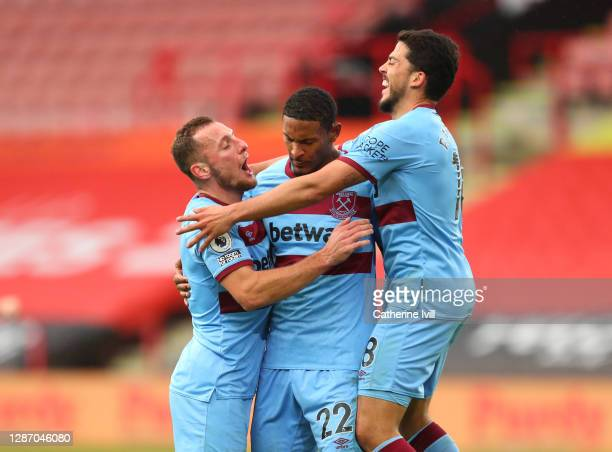Seébastien Haller of West Ham United celebrates after scoring their sides first goal with Pablo Fornals of West Ham United and Vladimír Coufal of...