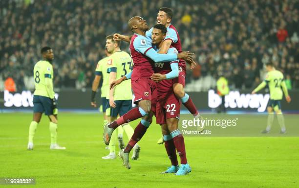 Sebastien Haller of West Ham United celebrates with Angelo Ogbonna and Pablo Fornals after scoring his team's second goal during the Premier League...