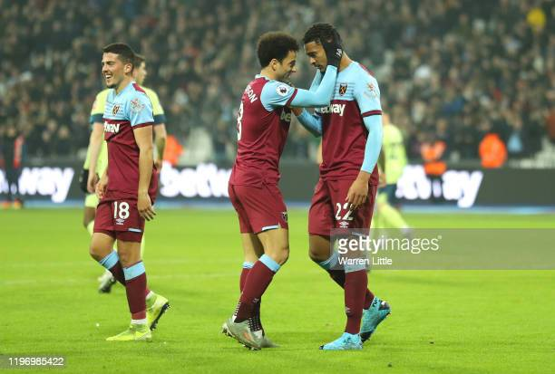 Sebastien Haller of West Ham United celebrates with Felipe Anderson after scoring his team's second goal during the Premier League match between West...