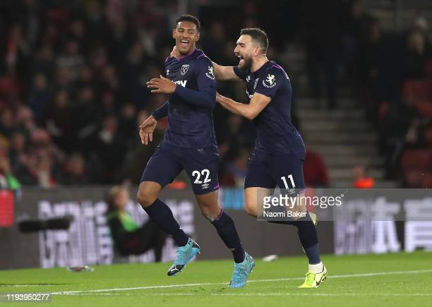 Sebastien Haller of West Ham United celebrates with teammate Robert Snodgrass after scoring his team's first goal during the Premier League match...