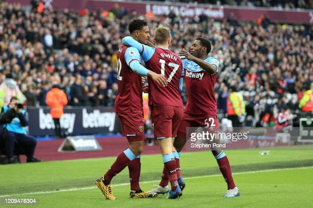 Sebastien Haller of West Ham United celebrates with teammates Jarrod Bowen and Jeremy Ngakia after scoring his sides second gaol during the Premier...