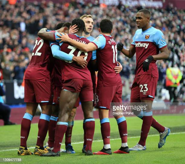Sebastien Haller of West Ham United celebrates with teammates Jarrod Bowen, Michail Antonio, Pablo Fornals and Issa Diop after scoring his sides...