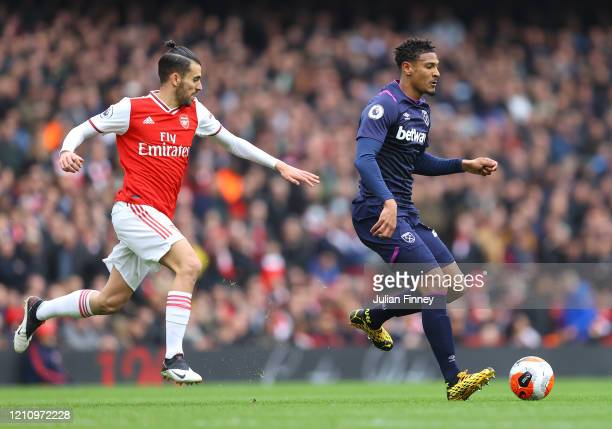 Sebastien Haller of West Ham United is challenged by Dani Ceballos of Arsenal during the Premier League match between Arsenal FC and West Ham United...