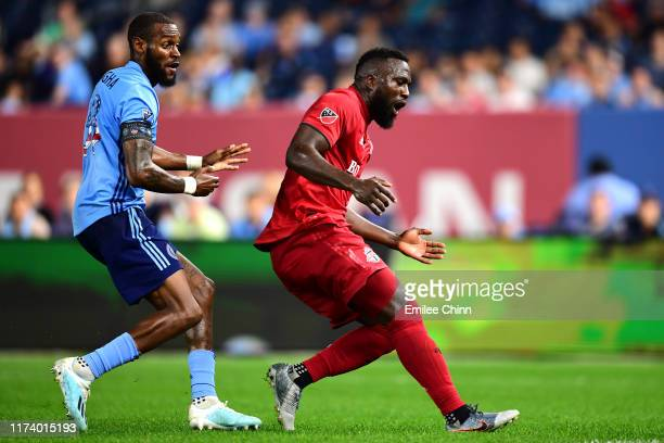 Sebastien Ibeagha of New York City FC and Jozy Altidore of Toronto FC watch after Altidore shoots the ball at Yankee Stadium on September 11 2019 in...