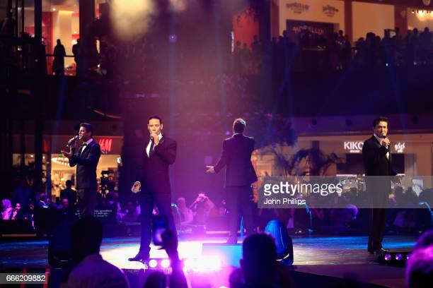 Sebastien Izambard, Urs Buhler, David Miller and Carlos Marin of Il Divo perform during the Grand Opening of The Mall of Qatar at Mall of Qatar on...