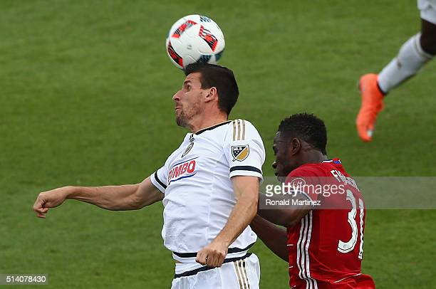 Sebastien Le Toux of Philadelphia Union heads the ball against Maynor Figueroa of FC Dallas in the second half at Toyota Stadium on March 6 2016 in...