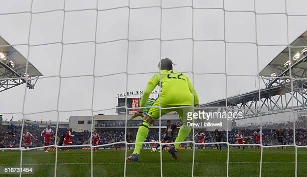 Sebastien Le Toux of Philadelphia Union takes a penalty shot on Bobby Shuttleworth of New England Revolution at Talen Energy Stadium on March 20 2016...