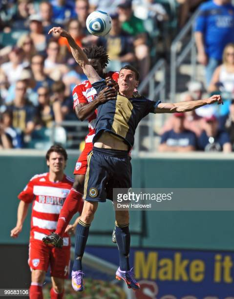 Sebastien Le Toux of the Philadelphia Union heads the ball in front of Ugo Ihemelu of FC Dallas on May 15 2010 at Lincoln Financial Field in...